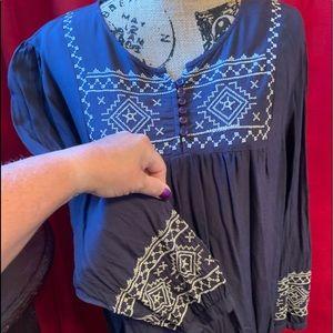 Tunic with unique stitch work